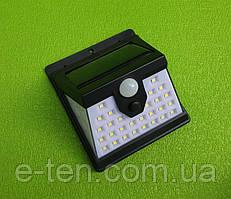 Вуличний світлодіодний настінний ліхтар-світильник T-2866 / 40 LED на сонячній батареї (з датчиком руху)