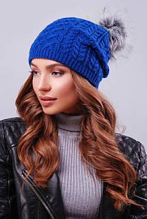Женская шапка синего цвета с пышным пампоном