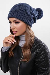 Женская шапка синего цвета с узорами и бубоном