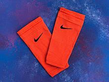Тримачі для шитков Nike (Помаранчеві)