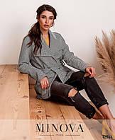 Женское короткое пальто серого цвета