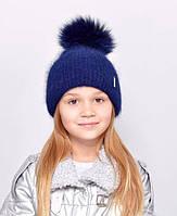 Красива, м'яка і тепла, зсередини підшита флісом дитяча шапка з бубоном синій