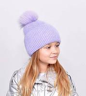 Красива, м'яка і тепла, зсередини підшита флісом дитяча шапка з бубоном лаванда