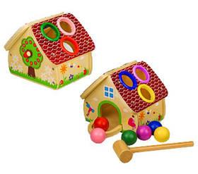 Деревянная игрушка домик-сортер стучалка
