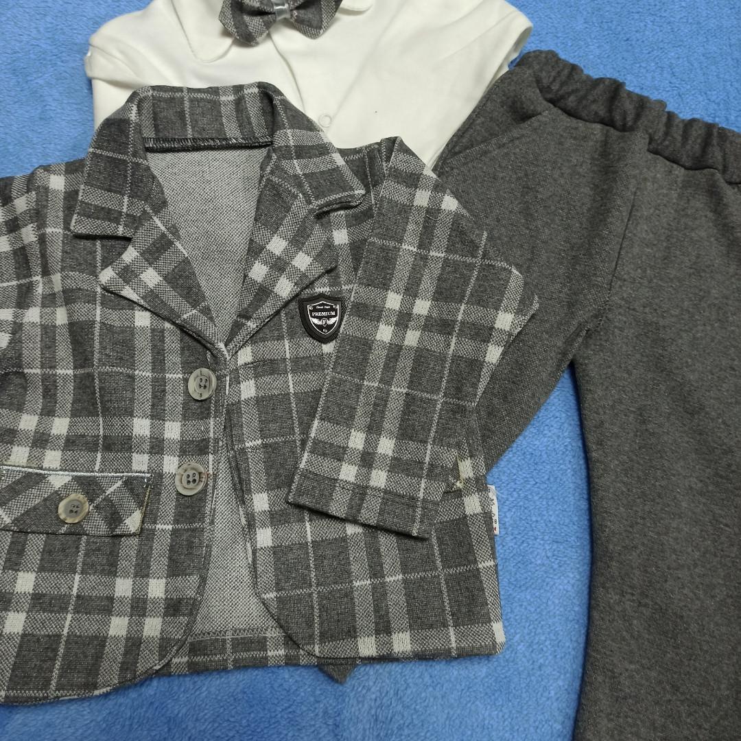 Нарядный модный красивый костюм для мальчиков. В комплект входит трикотажная рубашка. бабочка. пиджак. штаны.