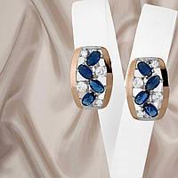 Красивые женские серебряные серьги 925 пробы с золотыми вставками и синими фианитами