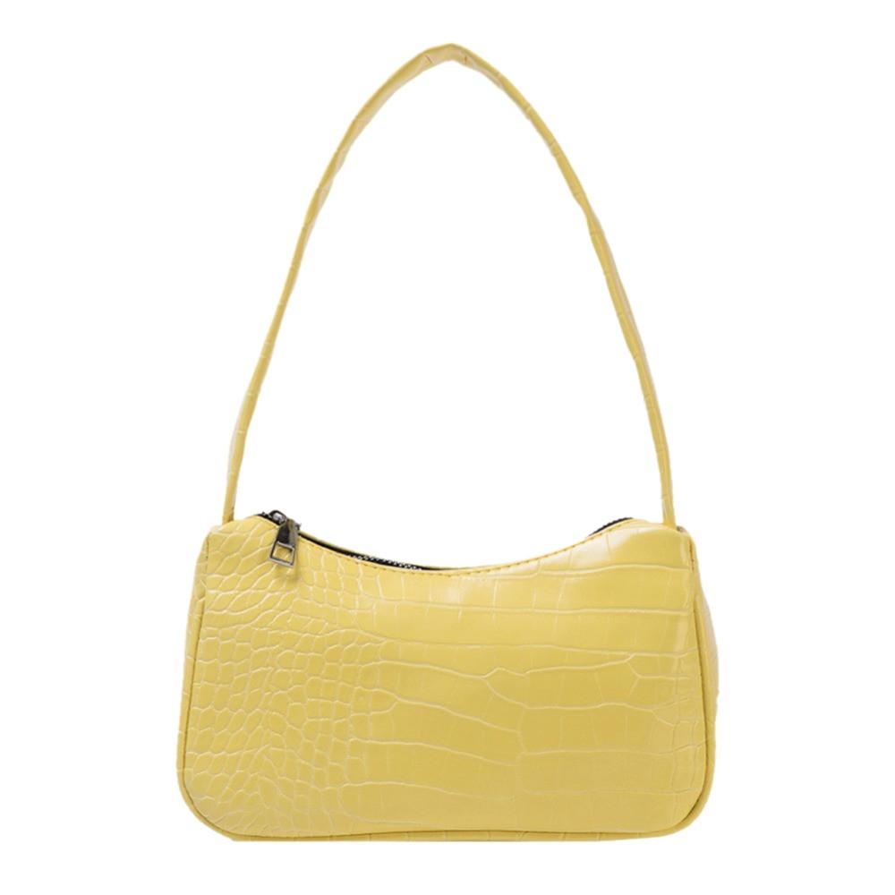 Женская сумочка лодочка из крокодила желтого цвета