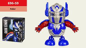 Робот батар. танцующий 696-59(72шт/2) свет, звук, р-р игрушки – 17*7.5*18 см, в кор.17*9,5*19см