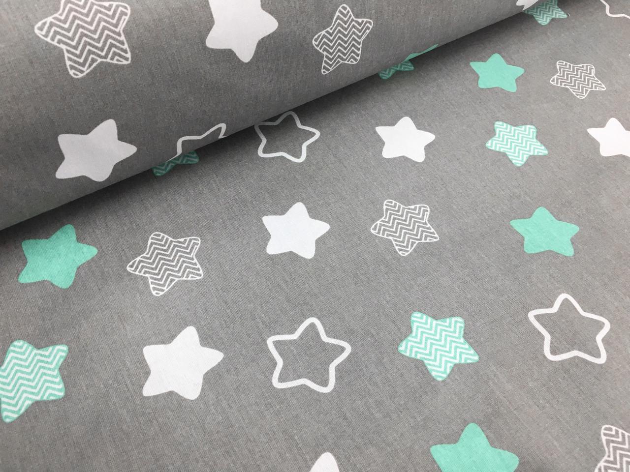 """Польская хлопковая ткань """"звезды (пряники) белые, мятные на сером"""""""