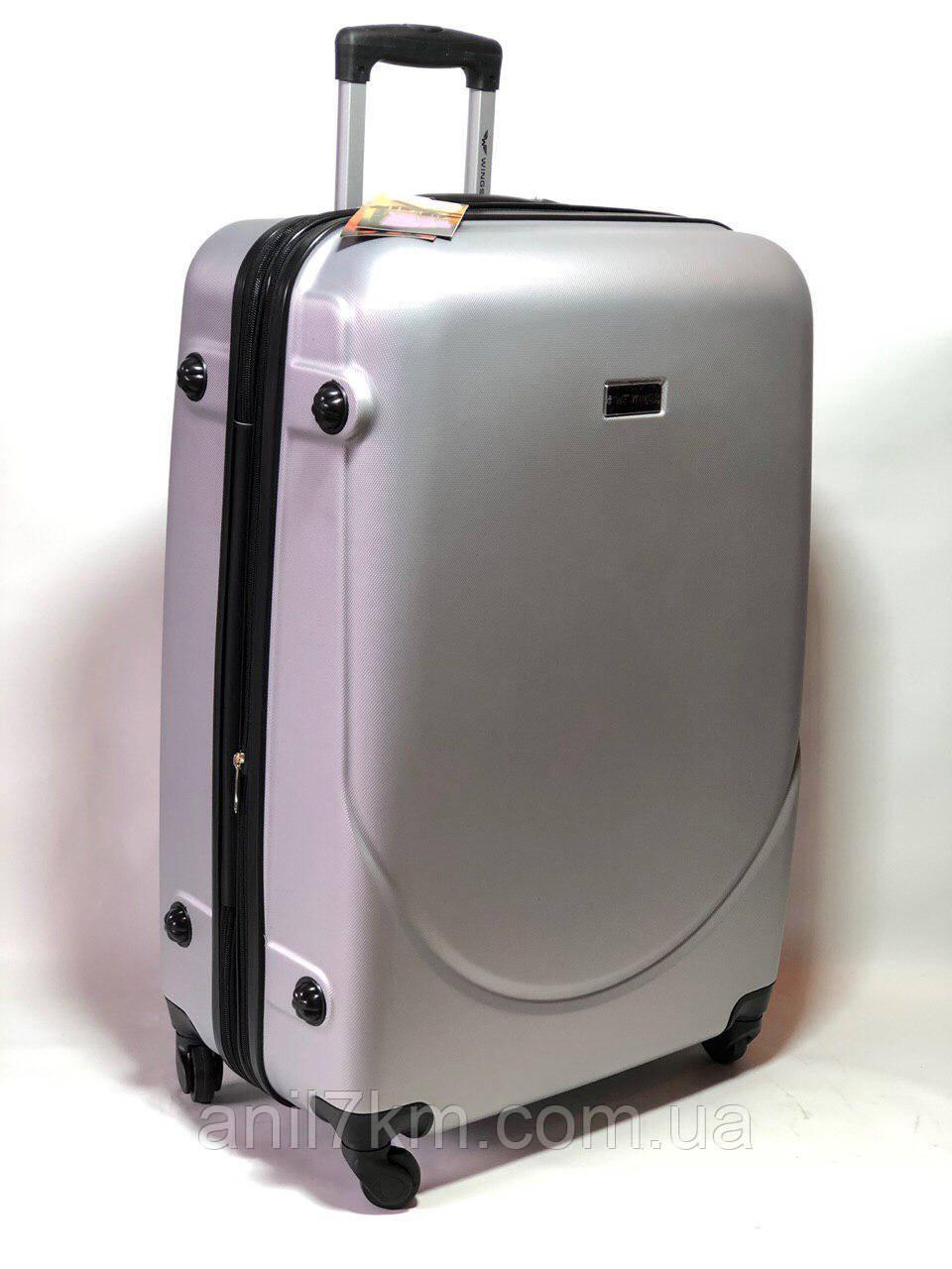 Великий пластиковий чемодан на чотирьох колесах wings