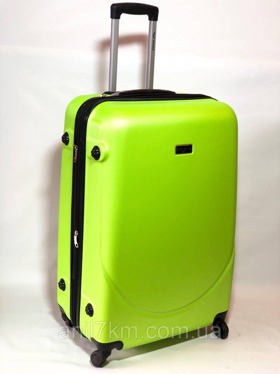 Середній пластиковий чемодан на чотирьох колесах wings
