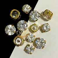 Фианиты в золотых цапах 8mm Crystal