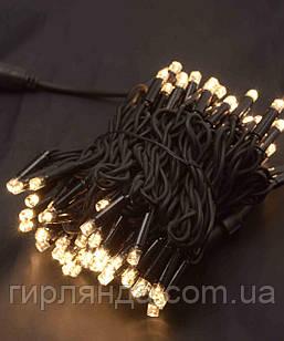 Вулична 100 LED,  10м,  чорний каучук 3,3мм, теплий білий