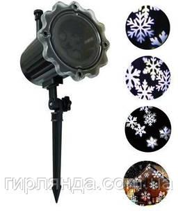 Проектор вуличний сніжинки білі