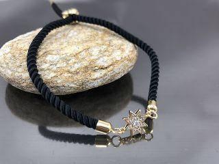 Браслет Звездочка на черном шнурке, цвет золото