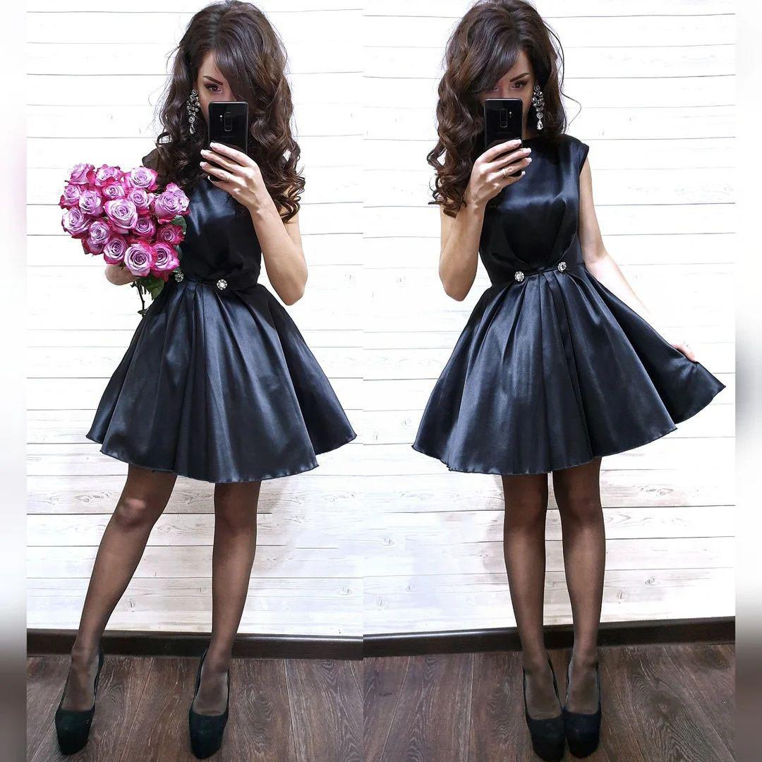 Платье нарядное из атласа с карманами выше колена