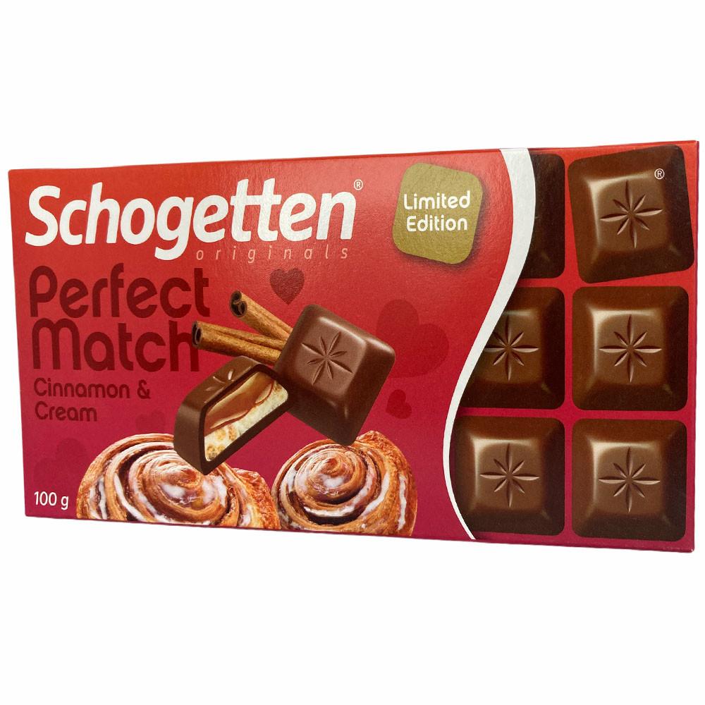 Шоколад молочный с кусочками печенья и корицы Schogetten