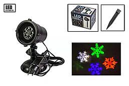 Лазерний проектор X-Laser для вулиці і вдома новорічний 4 кольори водонепроникний