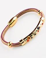Эксклюзивный  браслет со стильной золотой ставкой в камнях