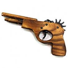 Детский игрушечный пистолет из дерева стреляет резинками