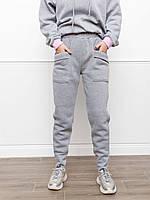 Светло-серые утепленные флисом брюки с карманами