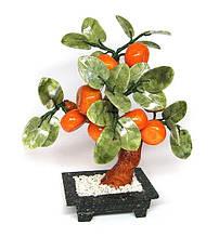 Дерево с мандаринами из камня
