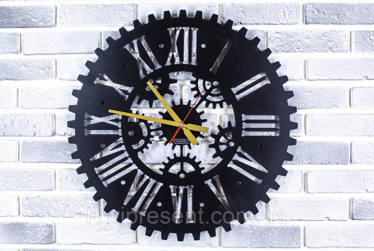 Настенные дизайнерские часы Круговорот Оригинальные металлические часы на стену