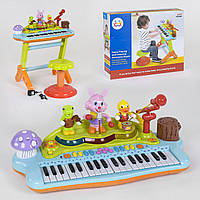 Детское пианино-синтезатор 669 на ножках с микрофоном и стульчиком световые эффектами, фото 1