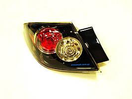 Фонарь задний для Mazda 3 хетчбек '07-09 левый внешний прозрачный BR5S51180D