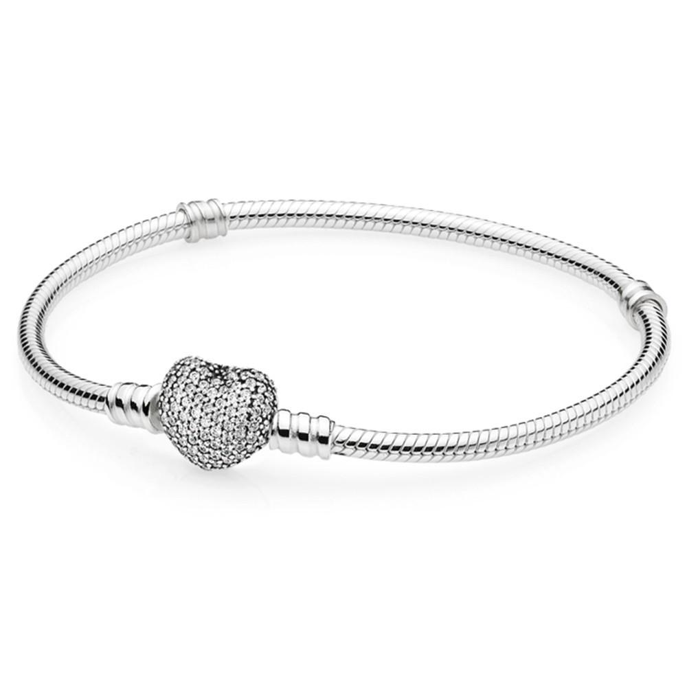 Серебряный браслет с застежкой в форме сердца украшенной камнями