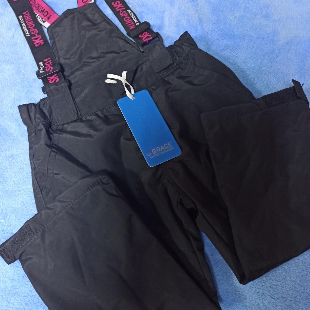 Термо штаны теплые модные красивые практичные чёрного цвета с отстежными подтяжками для девочки.