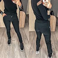 Тёплые брюки с карманами