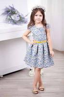Красивое детское платьице с ярким поясом