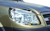Fiat Doblo II 2005↗ гг. Накладки на фары (2 шт, сталь) Carmos - Турецкая сталь, фото 1