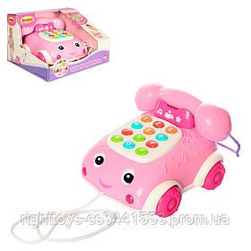 Каталка 0663G-NL (12шт) телефон, 17см, на шнурке, муз, зв,св, набат-ке, в кор-ке, 22-14-20см