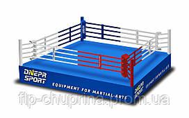 Боксерский ринг на помосте 7*7м, канаты 6*6м.