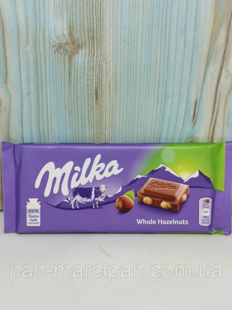 Шоколад Milka цілий лісовий горіх 100 г
