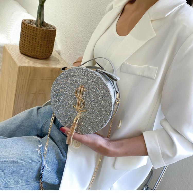 Блестящая круглая серебреная сумочка с косточкой через плечо