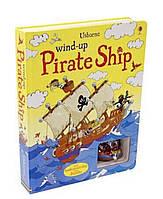 Книга Wind-up pirate ship. Usborne +заводная игрушка пиратский корабль