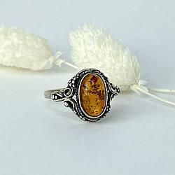 Кольцо из серебра с янтарем Ажур