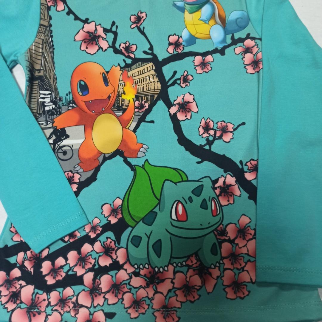 Модная красивая нарядная кофта для девочек. Цвет бирюзовый с ярким рисунком.