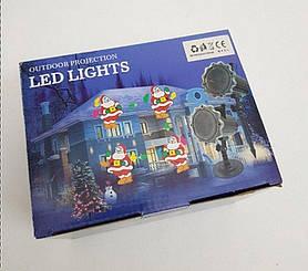 Новорічне лазерне шоу для будинку Діди Морози та Сніговики
