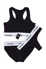 Комплект женского белья Calvin Klein тройка: топ + двое трусов черного цвета