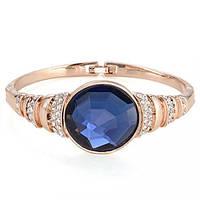 Шикарный вечерний браслет с круглым синим камнем в золоте
