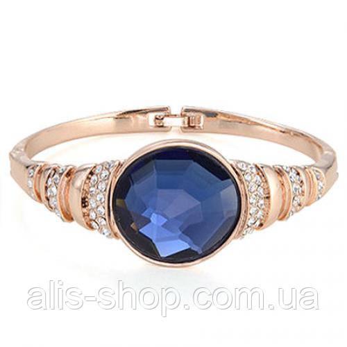 Шикарный вечерний браслет с круглым синим камнем в золоте и серебре