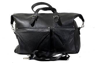 Дорожная сумка из плотной натуральной кожи черного цвета.