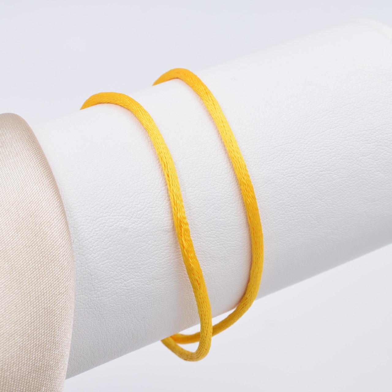 Шнурок шелковый цвет желтый длина 30 см ширина 2 мм вес серебра 0.7 г