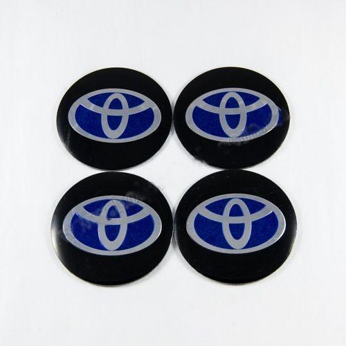 Наклейки на ковпачки Toyota чорні / синій лого 56 мм