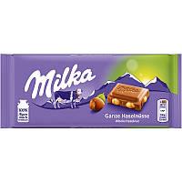 Шоколад Milka молочный с целым орехом 100г.