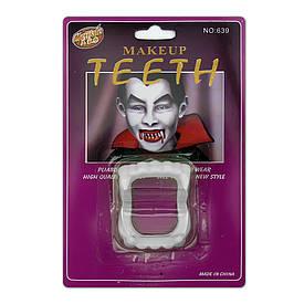 Зуби Вампіра світонакоплювальні на блістері